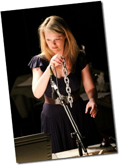 Rebecca Olson playing with chains